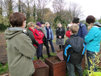 A group looks at hot boxes and wormery.
